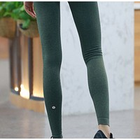 LULULEMON pure color all-around all-around running yoga workout pants with long legs and a seamless nine-point leg.Olive green