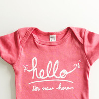 Hello I'm New Here - Funny text baby Onesuit (6-12 mo - coral)