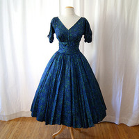 Gorgeous 1950's dark blue and green floral print by wearitagain