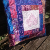 Quilted pillow cover with hand printed oak leaves surrounded with batiks for a 16 inch pillow #102