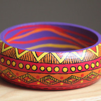 Hand painted wooden bracelet with Aztec pattern. Yellow, orange, red and purple handpainted bangle