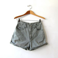 Vintage sage green jean shorts. high waisted shorts. roll up shorts. faded green denim shorts.