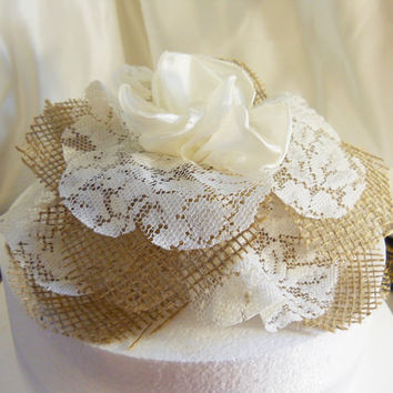 """Burlap Cake Topper Flower for wedding cake. Handmade of natural burlap, ivory lace and silk. Pics shown the flower on an 8"""" round."""
