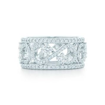 Tiffany & Co. -  Tiffany Enchant Scroll Band Ring in platinum with diamonds, 9 mm wide.