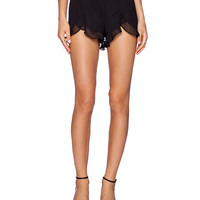 Black Pleated Shorts with Ruffle Hem Detail