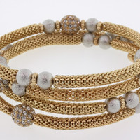 Barbado Spiral Bangle in Gold with Silver Beads