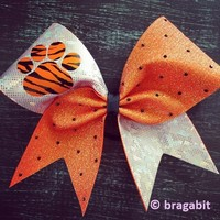 Holo orange glitter and white(silver) sparkly fabric with paw and black rhinestones