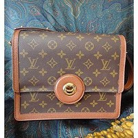 Tagre™ Vintage Louis Vuitton rare brown and monogram shoulder purse with bullet eye turn lock