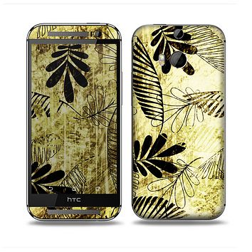 The Black & Gold Grunge Leaf Surface Skin for the HTC One M8