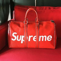 DCCK Supreme Fashion Print Leather Luggage Travel Bag Tote Handbag For Women Men Red
