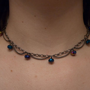 choker with colorful faceted glass beads and looped chain, mostly blues & purples on gunmetal toned chain