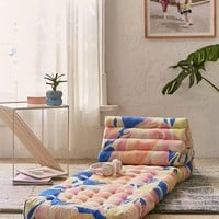 Convertible Printed Triangle Floor Cushion | Urban Outfitters