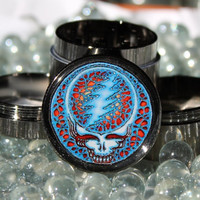 Small size Steal Your Face Grateful Dead herb grinder 4 piece gun metal with scraper