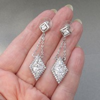 Dazzling Signed Nolan Miller 1990's Vintage Dangle Silver Tone Trilliant CZ Party Earrings