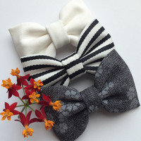 Black and white stripe, gray and black floral, and winter white hair bow lot from Seaside Sparrow.  Perfect accessory bow gift for her.