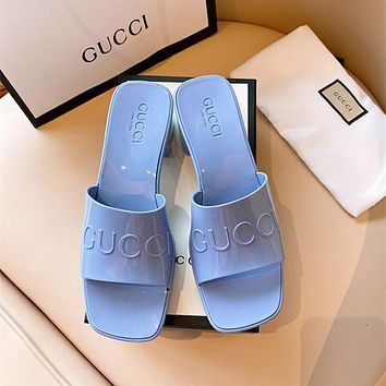 GUCCI Women's rubber slide sandal