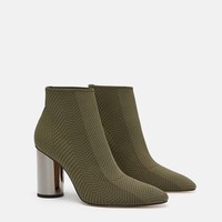FABRIC ANKLE BOOT WITH METALLIC HEEL DETAILS
