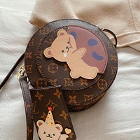 Louis Vuitton LV New Women's Cute Bear Print Alphabet Presby Round Cake Bag Diagonal Bag