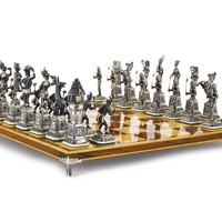 """A Spanish silver """"Egyptians and Nubians"""" chess set, 20th century 