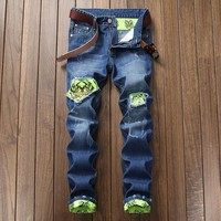 Ripped Holes Fashion Slim Strong Character Jeans [454562250781]