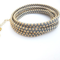 Blue cotton wax cord and a gold plated chain - 6X wrap bracelet