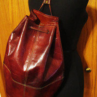 large vintage whiskey brown leather duffle backpack. Jack and Jones Collection. large leather backpack.