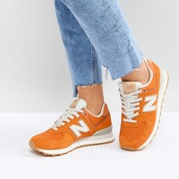 New Balance 574 Suede Trainers In Orange at asos.com