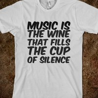 MUSIC IS THE WINE THAT FILLS THE CUP OF SILENCE