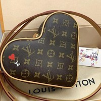 Louis Vuitton LV Hot Sale Women's Personality Zipper Heart-shaped Bag Shoulder Messenger Bag