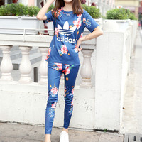 """""""Adidas"""" Fashion Casual Multicolor Clover Letter Flower Print Short Sleeve Set Two-Piece Sportswear"""