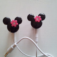 Black Minnie Mouse earbuds with a pink flower