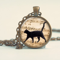 Pendant with Chain - A black Cat walking on music notes