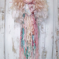 Shabby chic ornate wall decor feathered wings dripping with tattered ribbon pearls lace Anita Spero