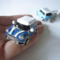 Dark blue car, white stripes and white  roof,drop of oil plus, grade crystal,