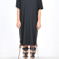 This soft tri-blended jersey knit midi dress features a round neckline, short sleeves, loose fitting oversize construction, midi length, side lace up design with grommets and contrast with brawn lace. Unlined. Pair with lace up gladiator, floppy hat and fr