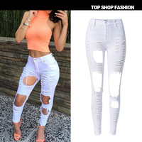 2016 plus size pants elastic waist Slim European and American models irregular hole personality jeans in black and white