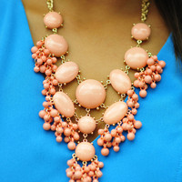 Strands Of Change Necklace: Coral | Hope's