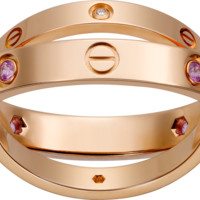LOVE ring, 4 pink sapphires, 2 diamonds: LOVE ring, 18K pink gold, set with 4 pink sapphires and 2 brilliant-cut diamonds.