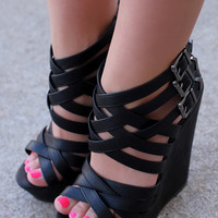 Stretch Out On The Boardwalk Wedges: Black