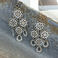 White Metal Flower Shaped Chandelier Earrings Accented With Gold Coloring