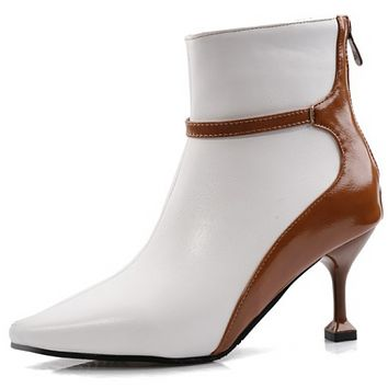 The new model is a hot seller of pointy patchwork ankle boots shoes