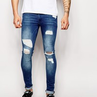 ASOS Extreme Super Skinny Jeans With Mega Rips at asos.com