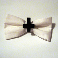 white inverted cross bow