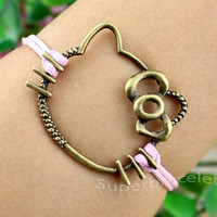 Hello Kitty of friendship bracelets - bronze bracelets - pink leather cord bracelet - gift to girlfriend and BFF
