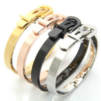 Fashionable and creative horseshoe button bracelet gold and silver belt buckle personality fashionable men and women titanium steel bracelet
