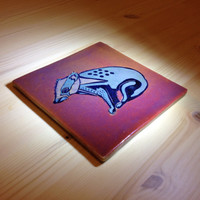 Silvery Badger on a rich orange ground , Lustreware tile