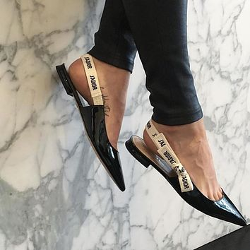 Dior pointed patent leather loaf slippers