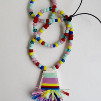 Hand embroidered pendant necklace with mint green, lavender, yellow, red, and blue on black leather cord with colorful matching glass beads