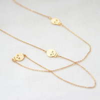 Gold Long Necklace with three skulls