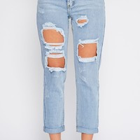 Lisa Light Wash Ripped Mom Jean - Jeans - PrettyLittleThing | PrettyLittleThing.com